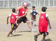 Stars align for children's footy clinic